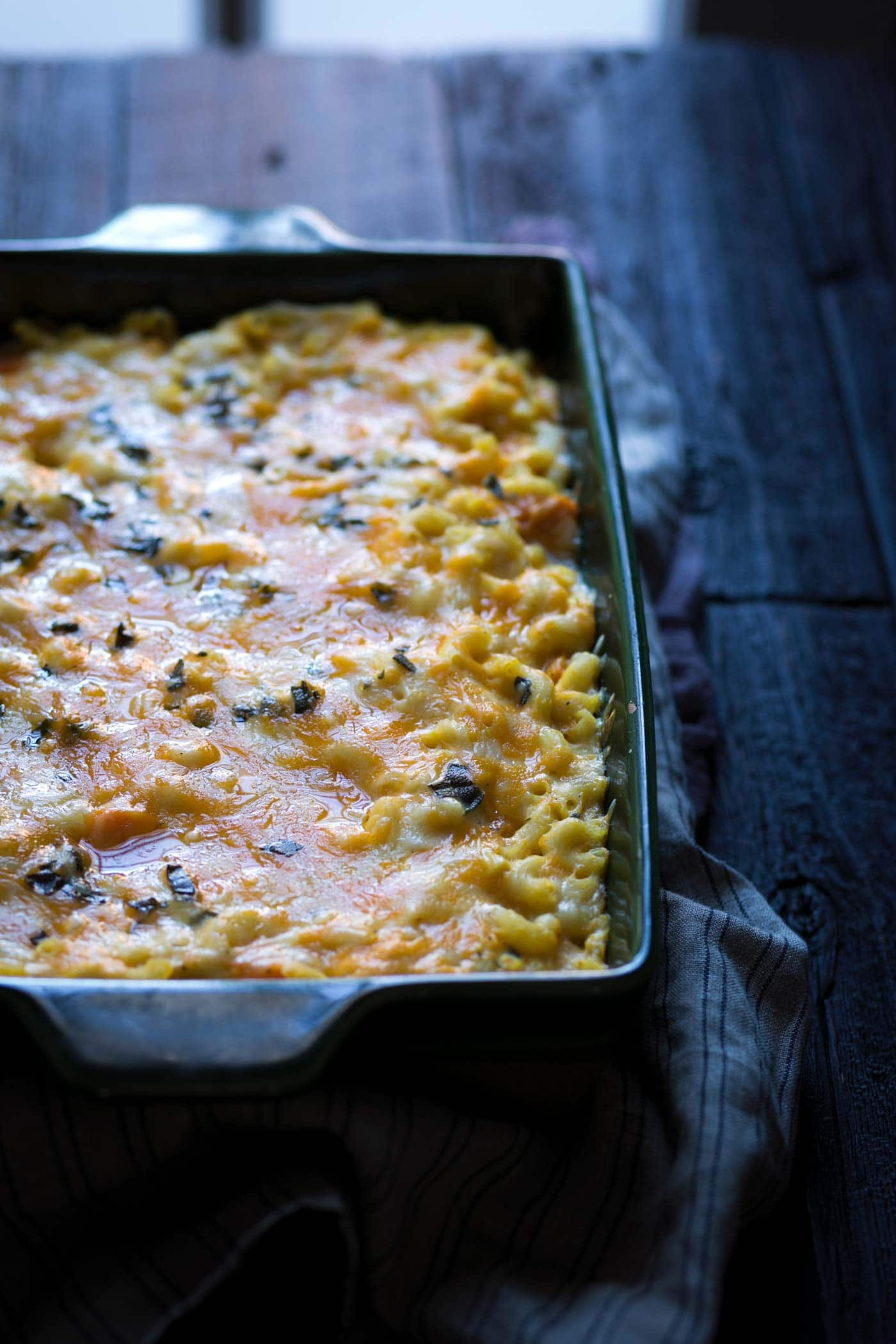 A photo of baked butternut squash macaroni and cheese, right out of the oven.