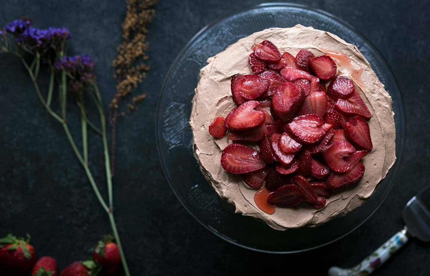You're going to love this decadent chocolate cake with macerated strawberries! Get the recipe from Savory Simple.
