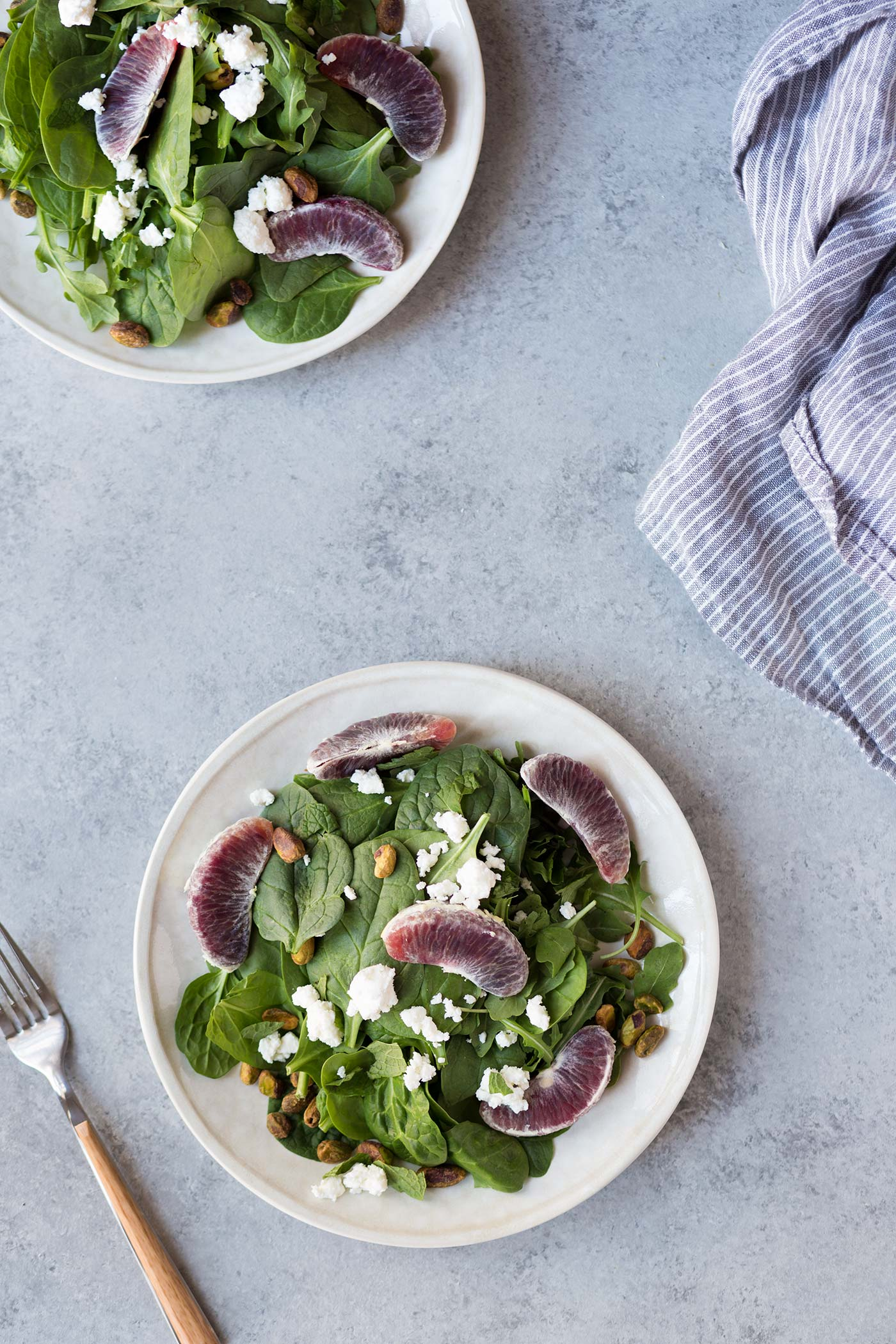 This Mixed Greens Salad with Feta, Blood Oranges, Mint & Pistachios has a perfect balance of flavors, textures & colors! Get the recipe from Savory Simple.
