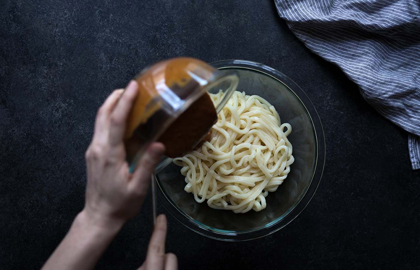 Short on time? These Spicy Cashew Butter Udon Noodles come together in 10 minutes! Get the recipe from Savory Simple.
