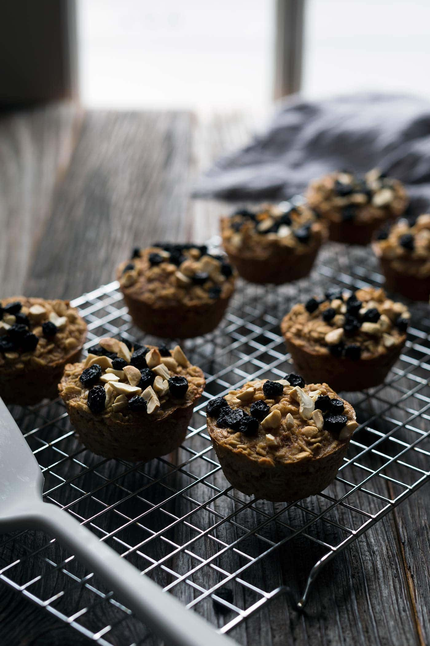 Baked Oatmeal Cups are wonderful for a quick breakfast or midday snack. They come together quickly and freeze beautifully so that you can easily store leftovers.