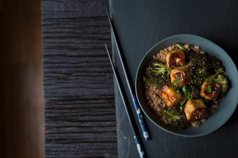 an overhead shot of crispy tofu and broccoli served over rice