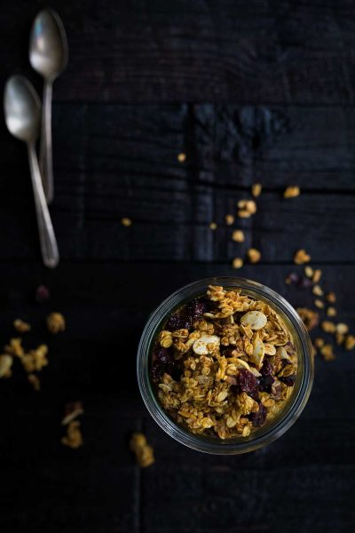 Pumpkin Granola with Pecans and Cranberries is perfect as a breakfast or snack. It's full of healthy ingredients, with just a hint of sweetness from maple syrup.