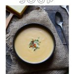 Cheesy potato soup with text overlay.