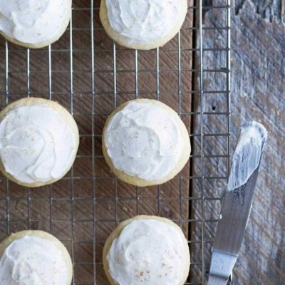 Frosted eggnog cookies on a cooling rack