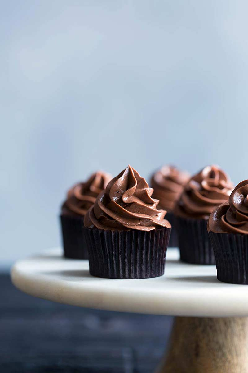 chocolate cupcake recipe displayed on a cake stand