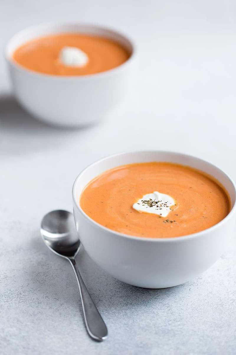 A birds eye photo of tomato bisque soup.