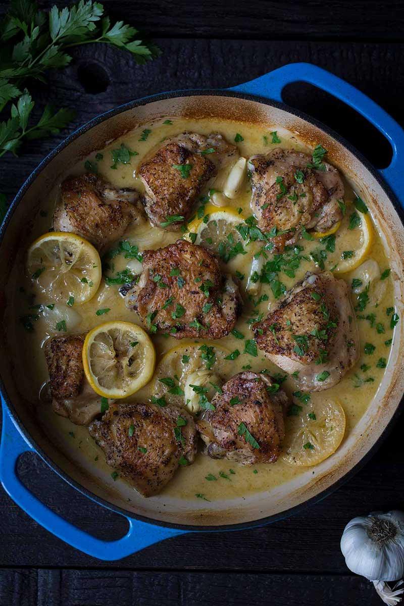 crispy chicken thighs in a round casserole dish