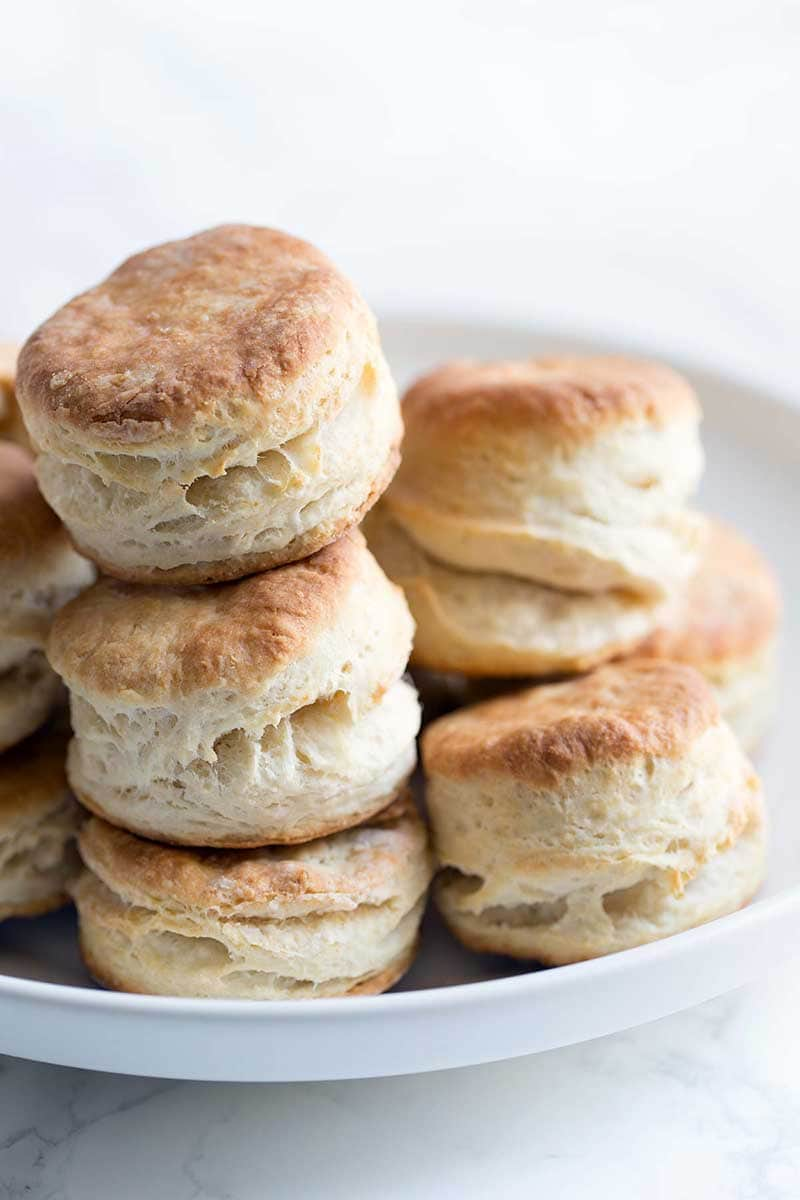 A close up of mile high homemade biscuits prepared using buttermilk. Super light and fluffy.