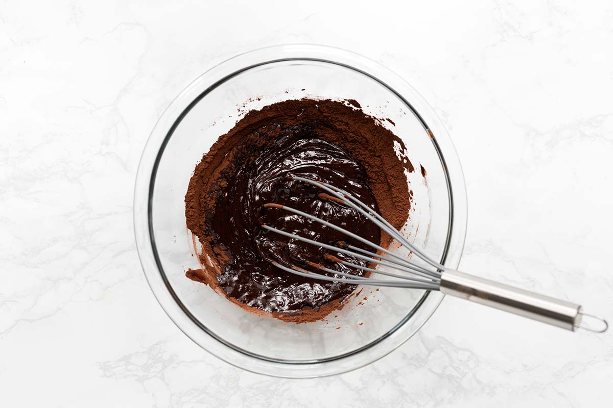 melted chocolate and cocoa powder in a bowl with a whisk; two ingredients worth splurging on