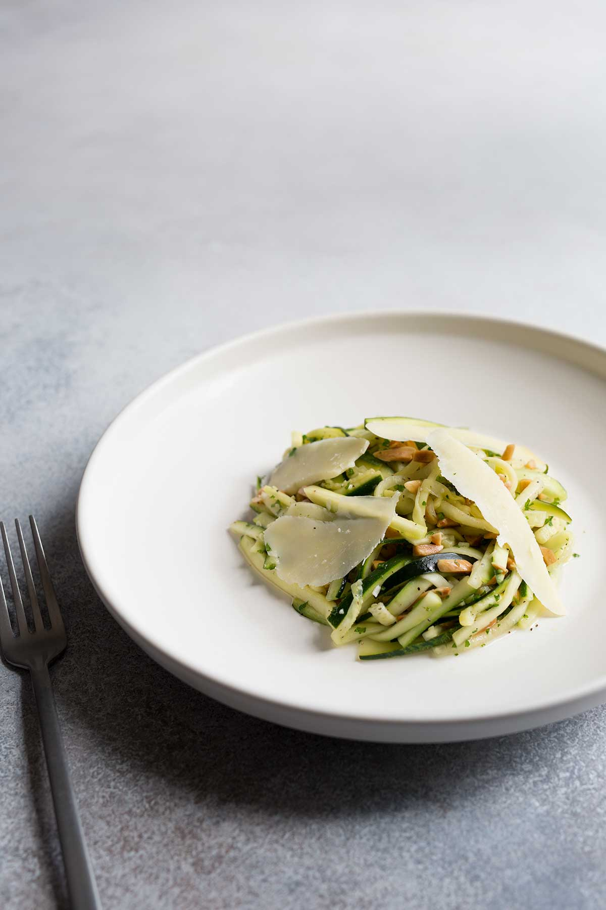 Zucchini salad topped with shaved cheese