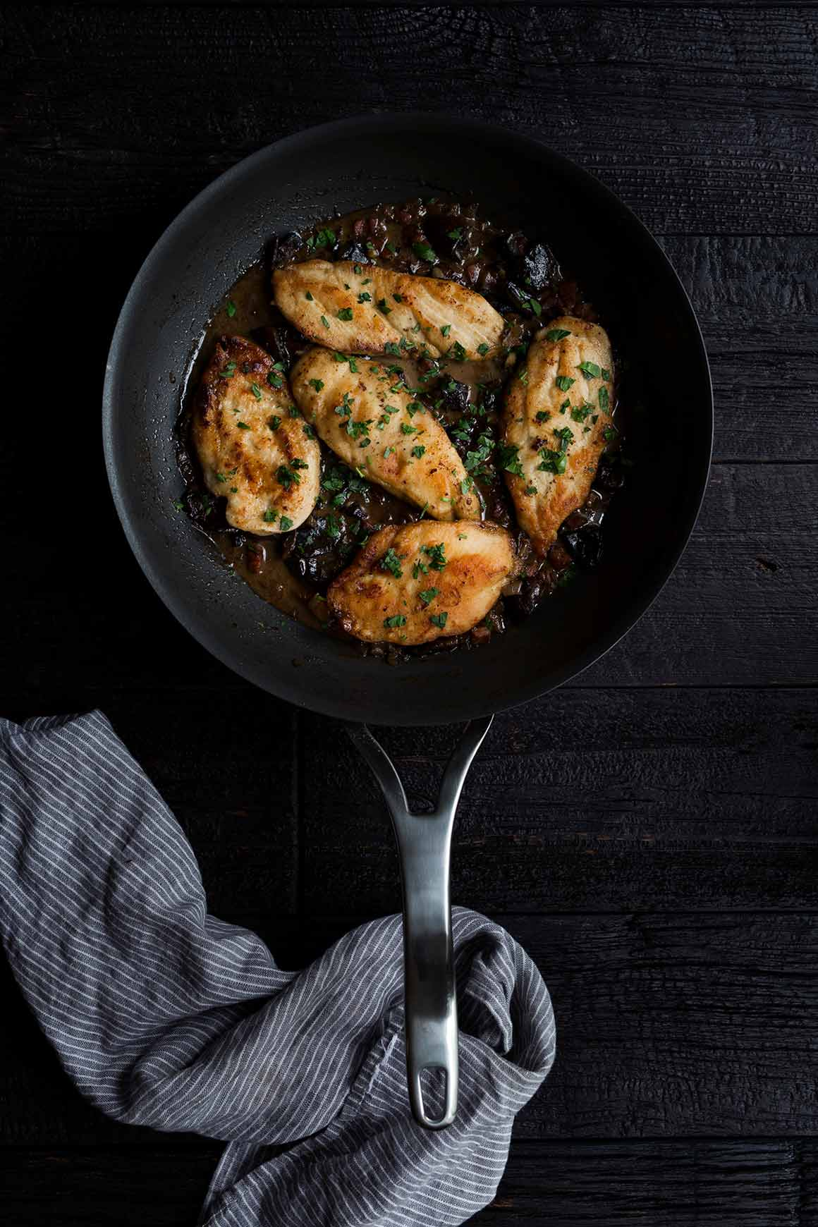 Chicken Marsala in a large nonstick skillet, topped with fresh parsley.