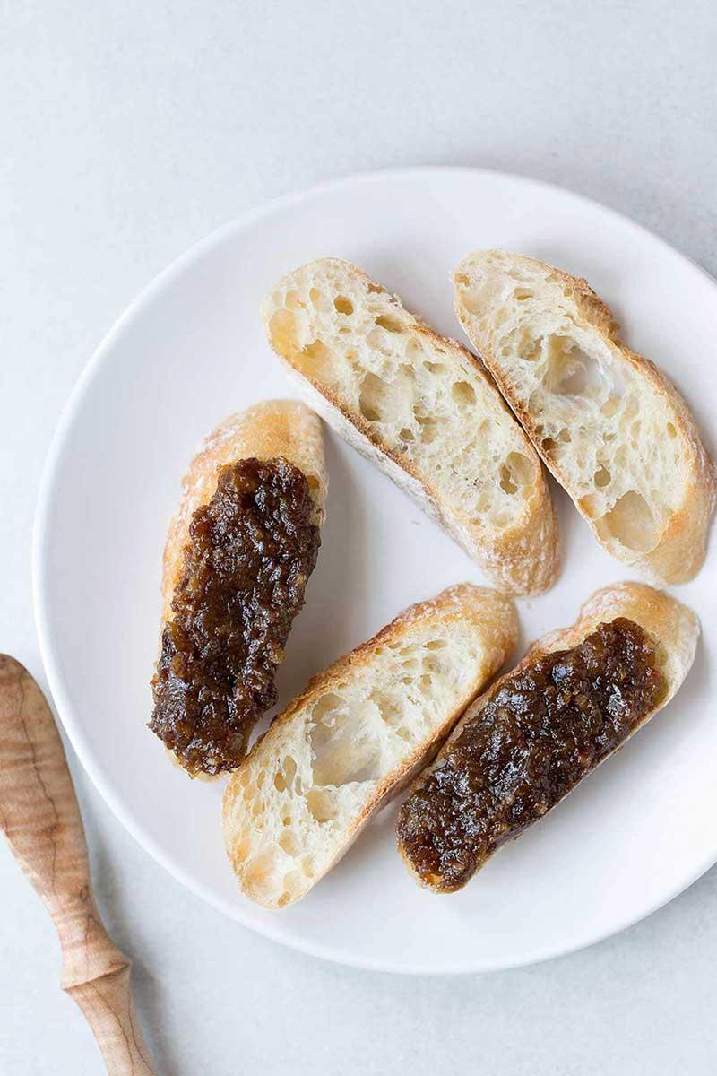 Bacon jam spread on crostini.