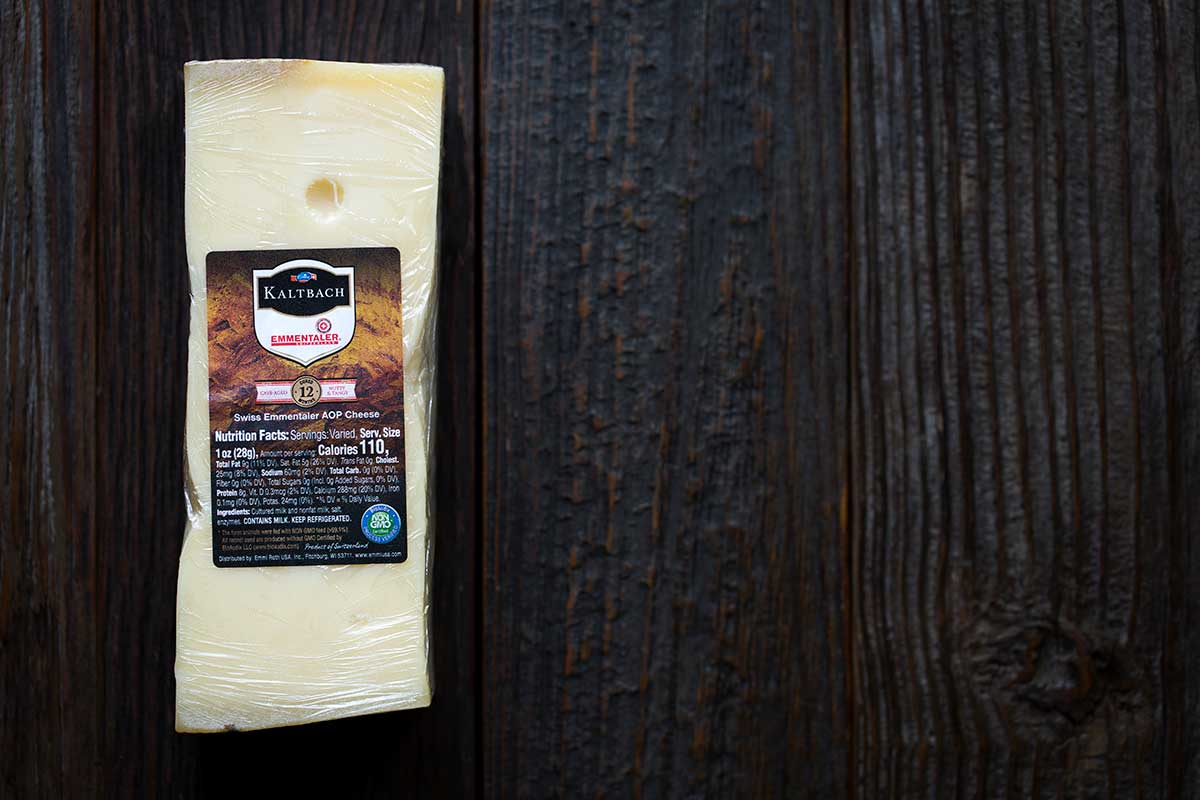 A block of aged swiss cheese from Emmi USA.