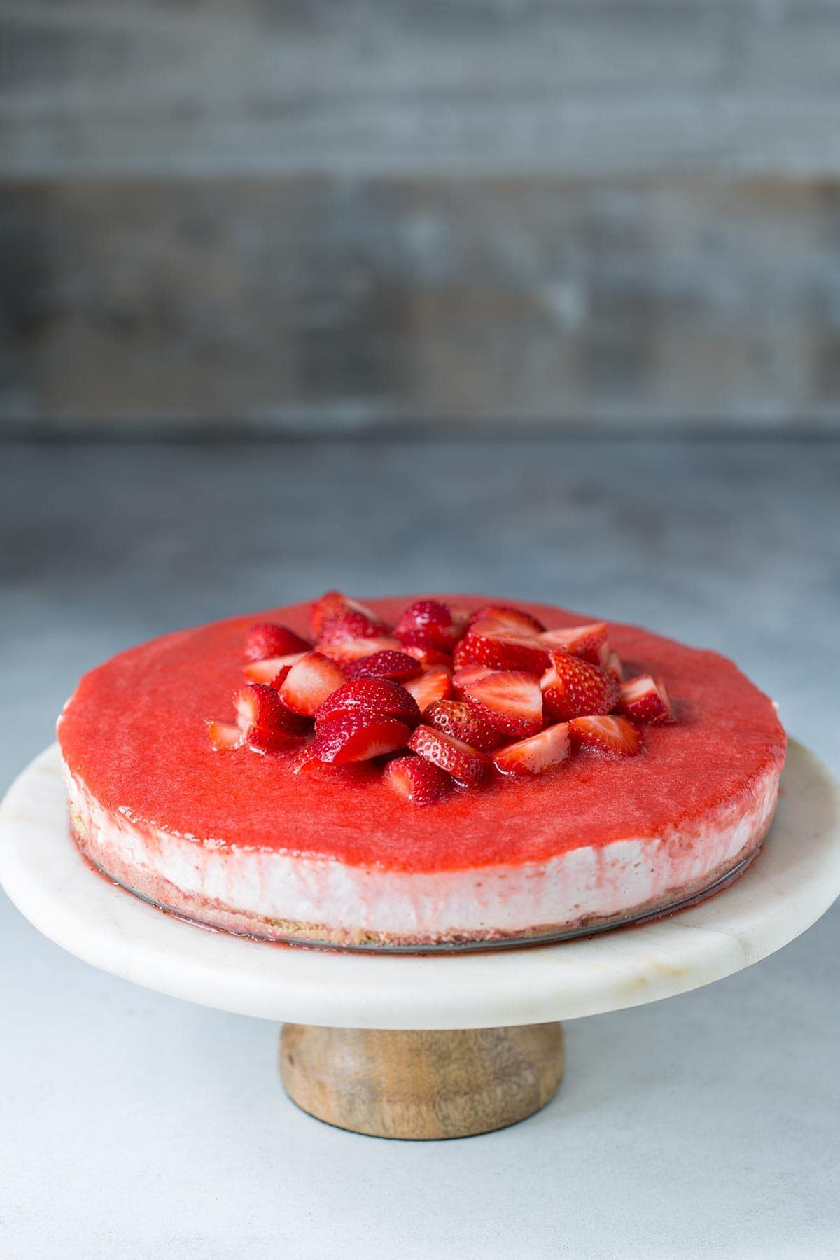 An easy no bake cheesecake recipe topped with strawberry puree and fresh strawberries.