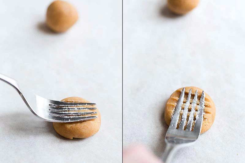 Using a fork to shape peanut butter cookies