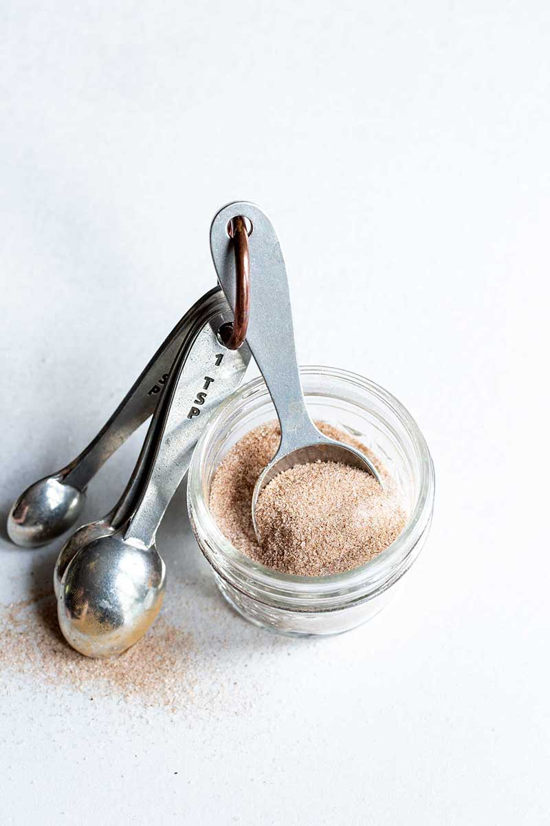 Cinnamon-Sugar Recipe in a mason jar with measuring spoons
