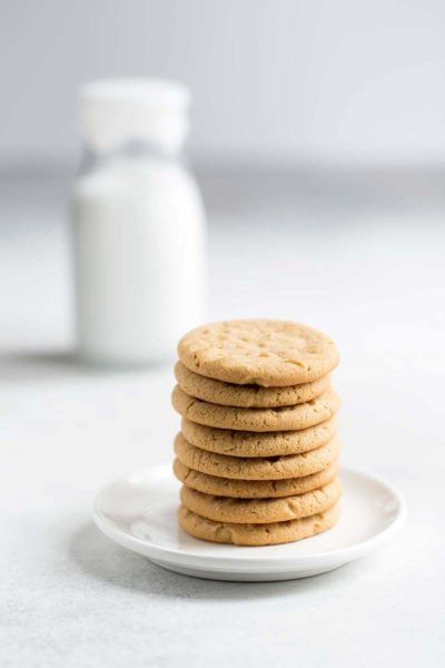 A stack of old fashioned peanut butter cookies on a plate