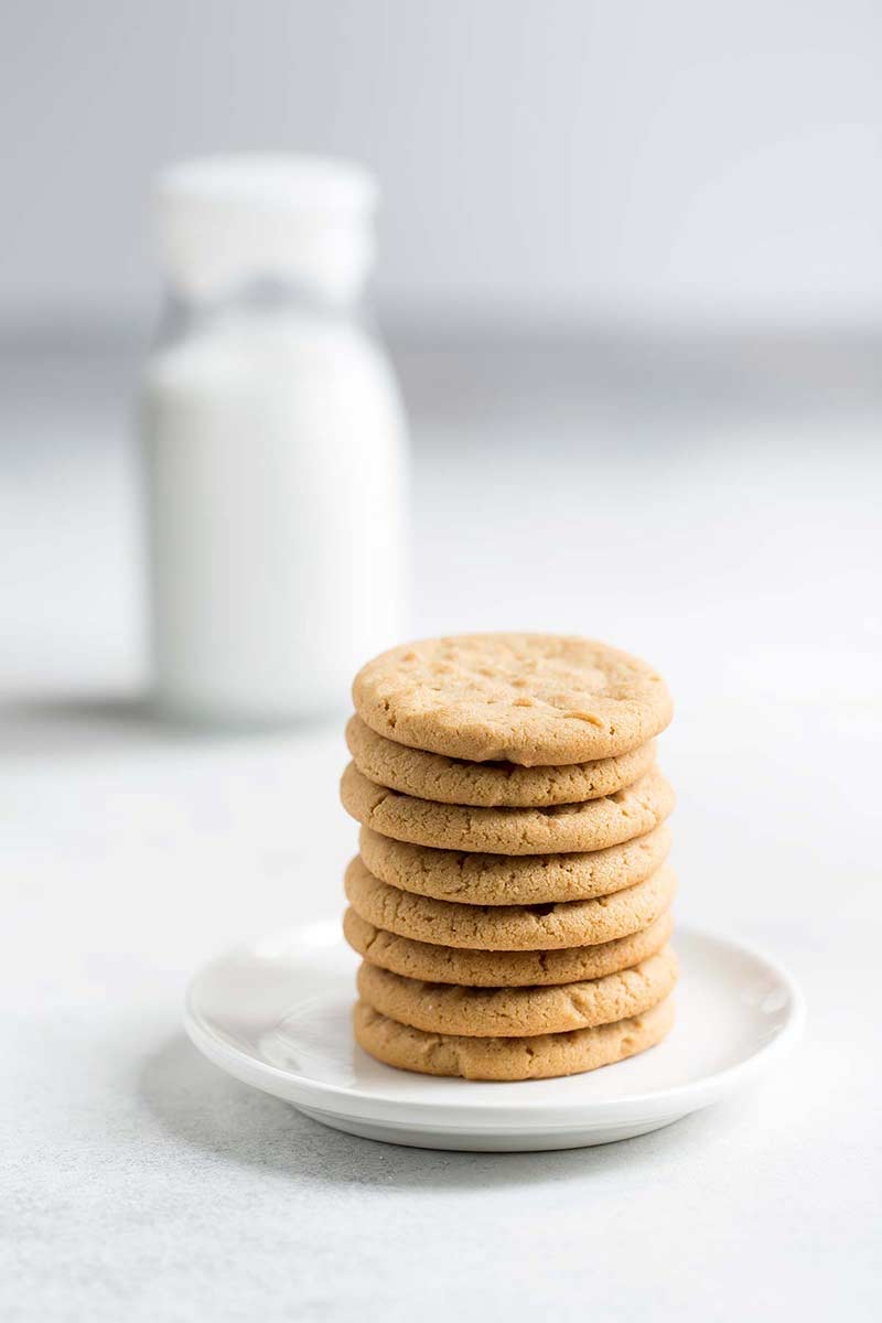A stack of Peanut butter cookies on a plate