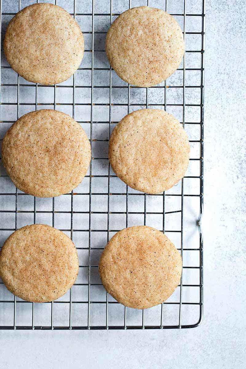 Snickerdoodle cookies on a cooling rack.