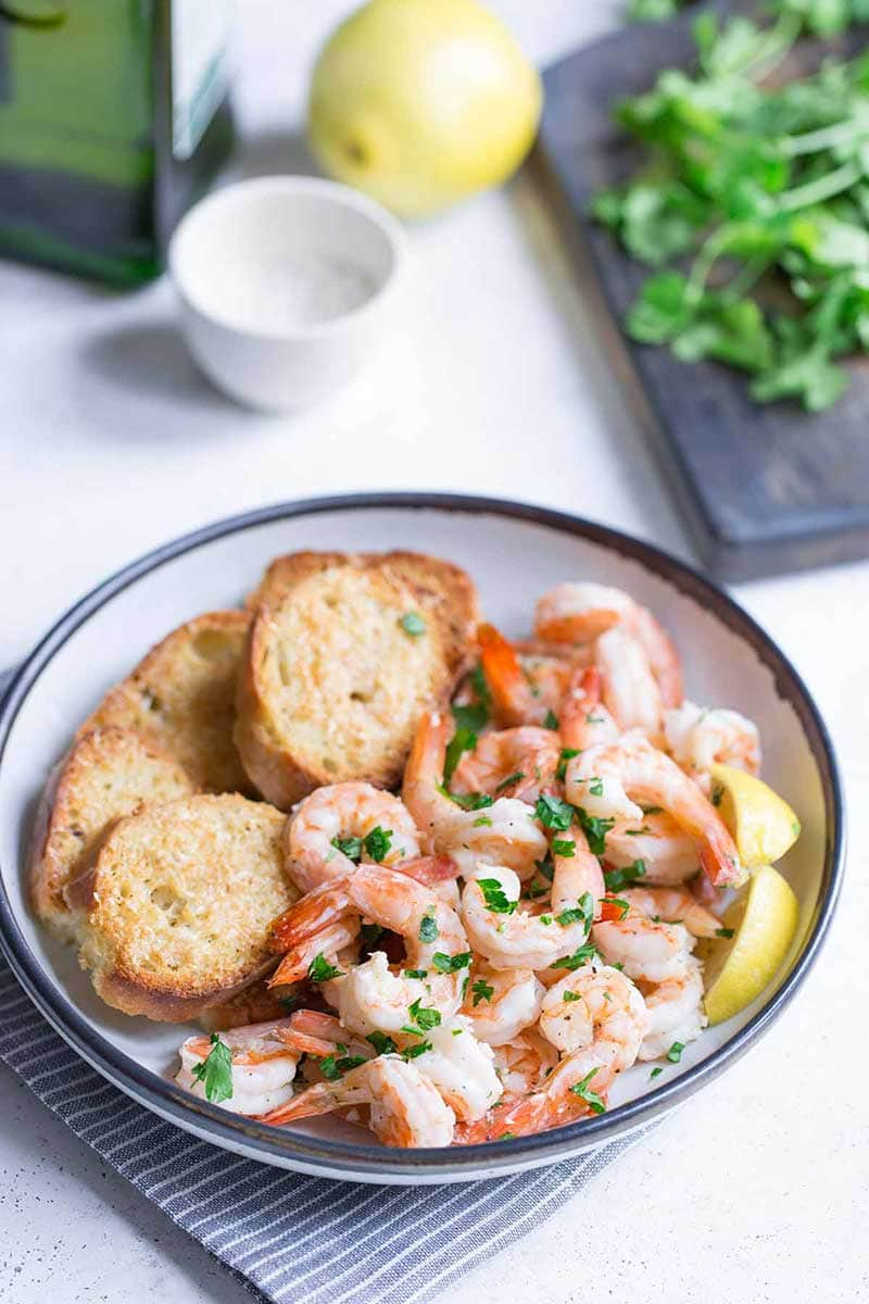 Bowl with garlic butter shrimp scampi