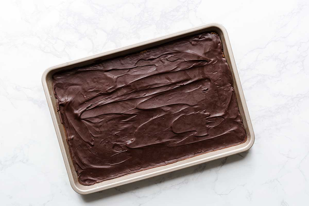 The chocolate layer spread over graham cracker crust.