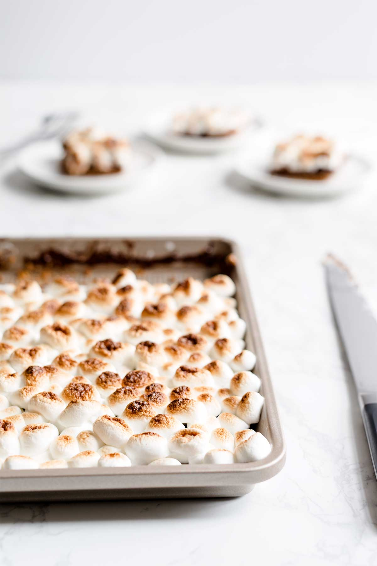 S'mores slab pie in front of 3 slices of pie.