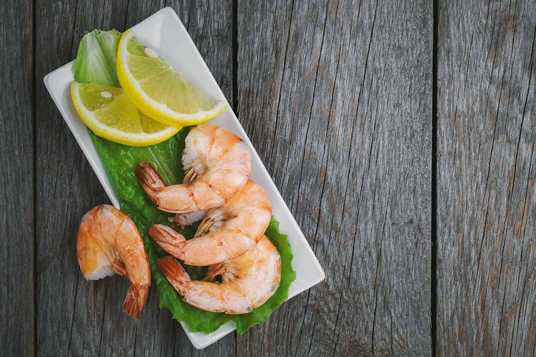 Shrimp on a plate with lemon