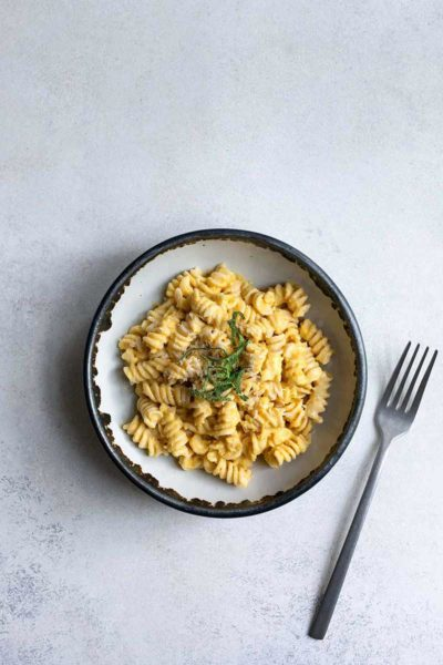 Creamy, homemade butternut squash pasta with sage in a bowl
