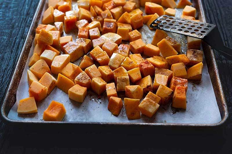 butternut squash cubes on a sheet pan