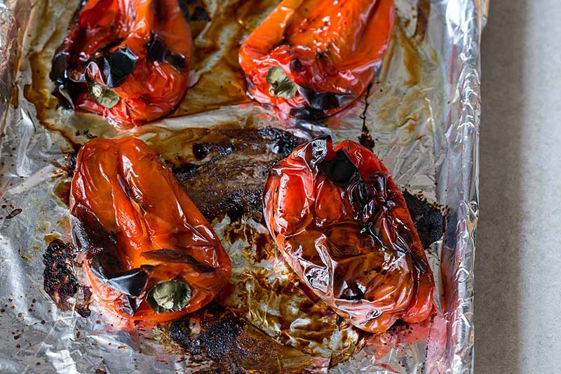 Roasted red peppers with the charred skins still attached