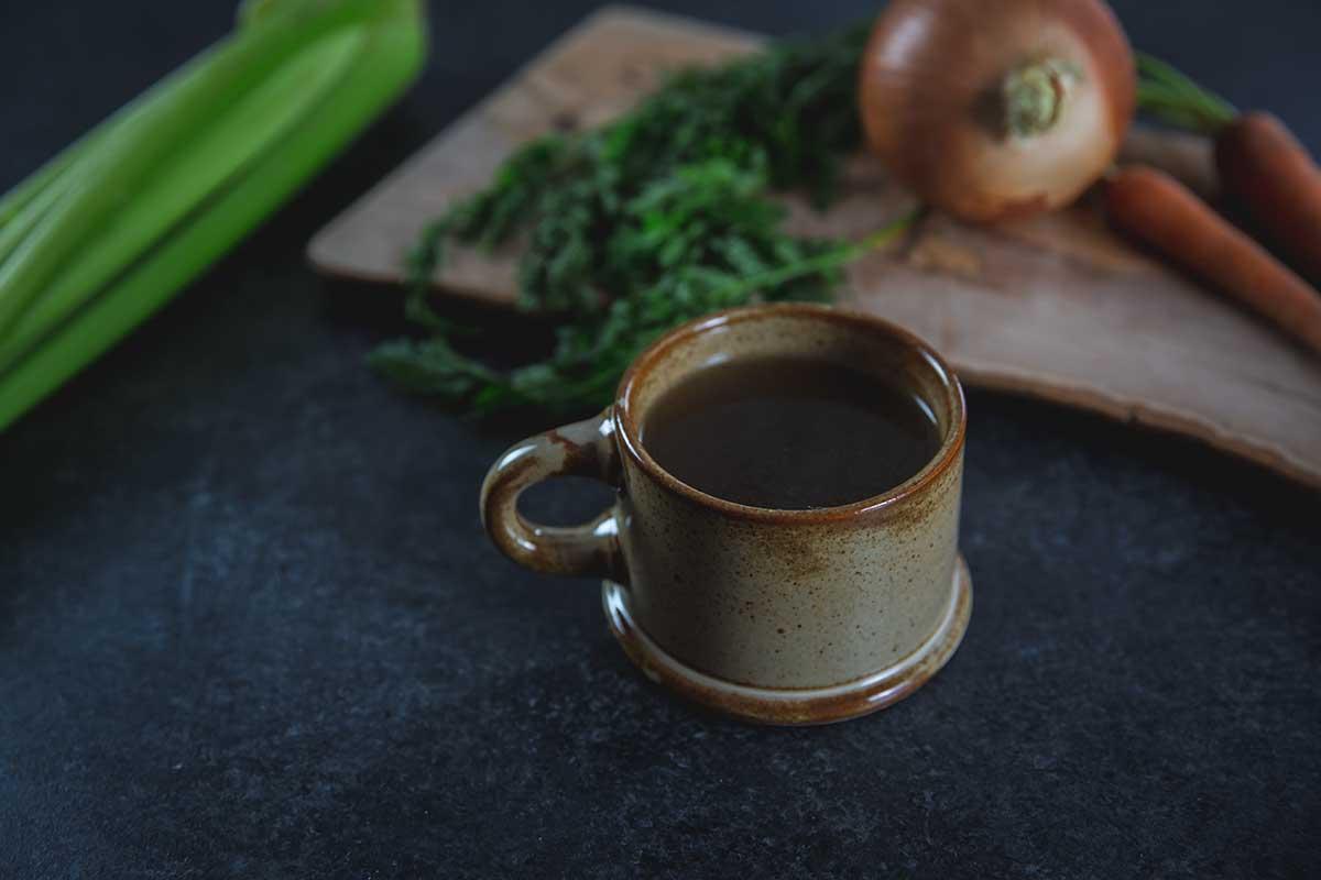 Crockpot bone broth in a mug