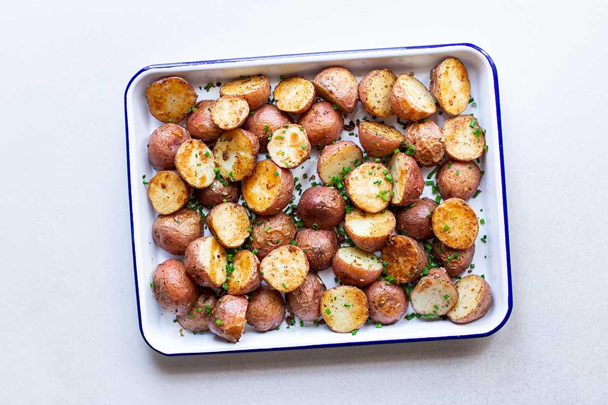 Crispy Roasted Potatoes in center of frame