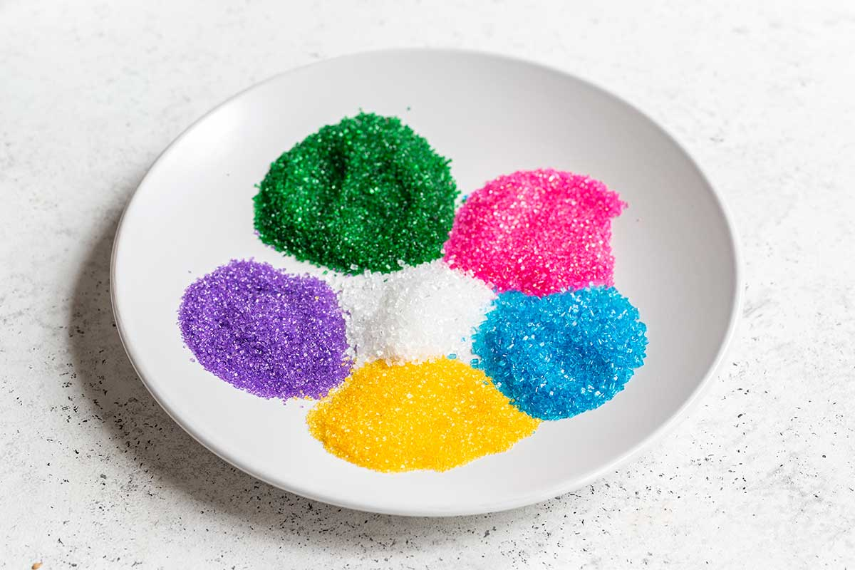 Different colors of sanding sugar on a plate