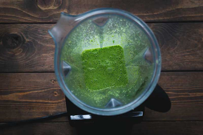 Overhead shot of cilantro dressing in a blender