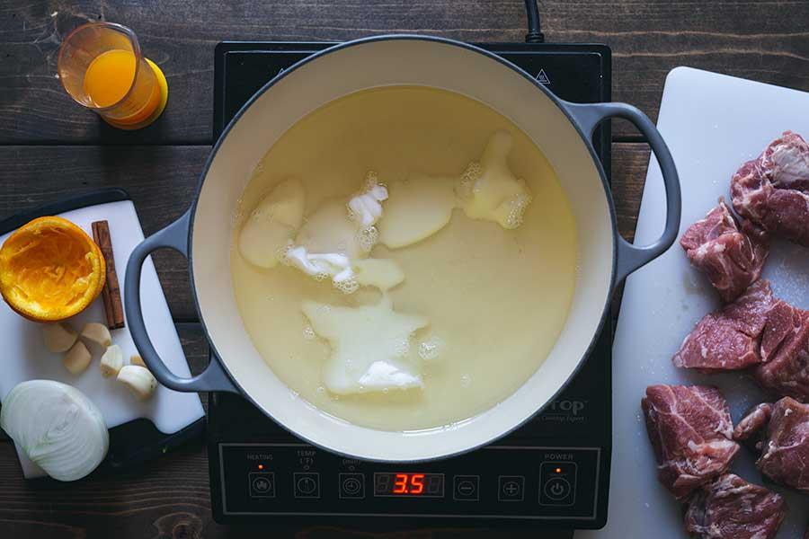 Lard melting in a Dutch oven