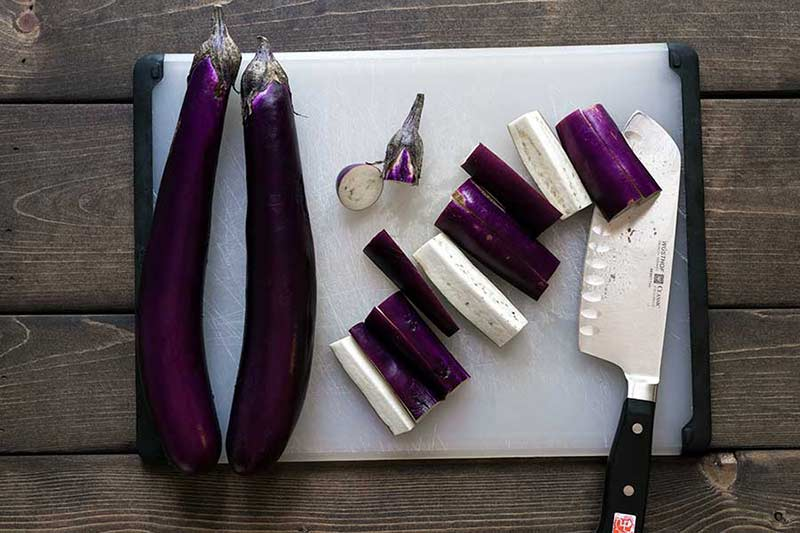 Eggplant being sliced into strips