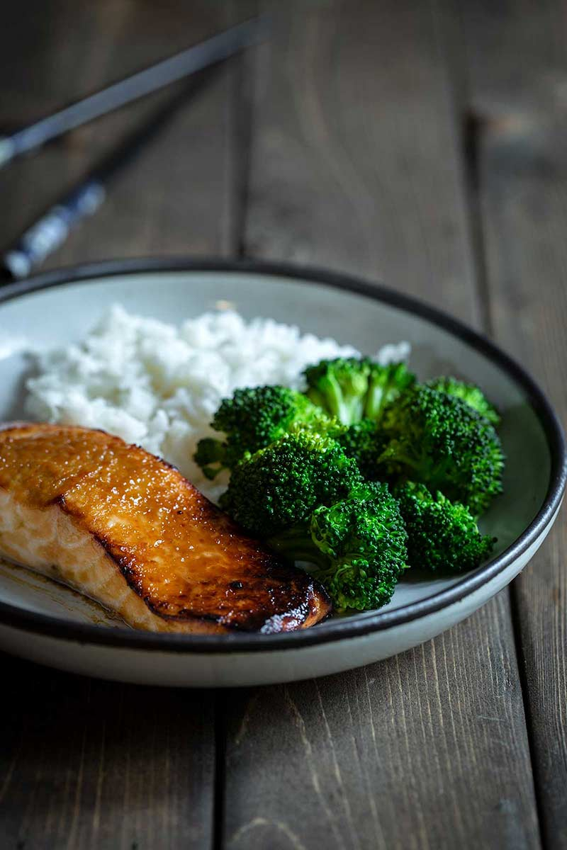 Miso salmon recipe on plate with rice and broccoli