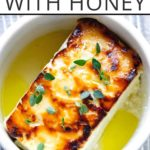 baked feta in a ramekin with honey and thyme