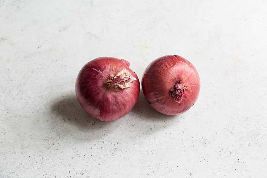 red onions on a white backdrop