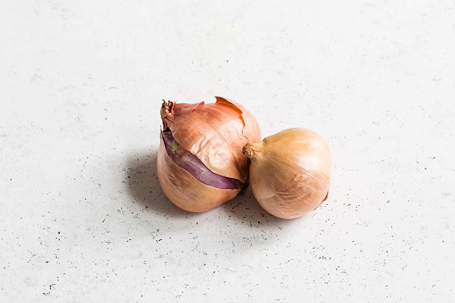 shallots on a white backdrop