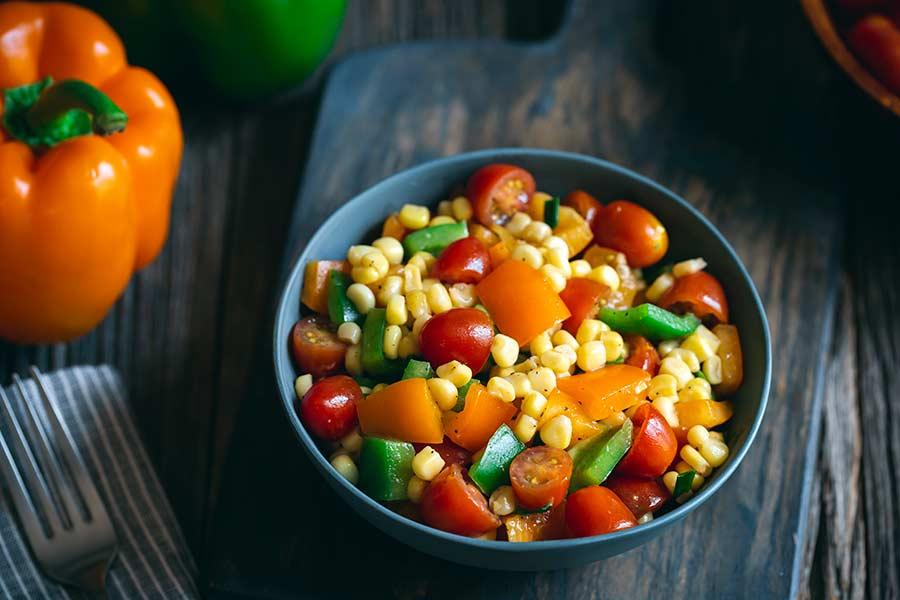 Corn salad in a grey bowl
