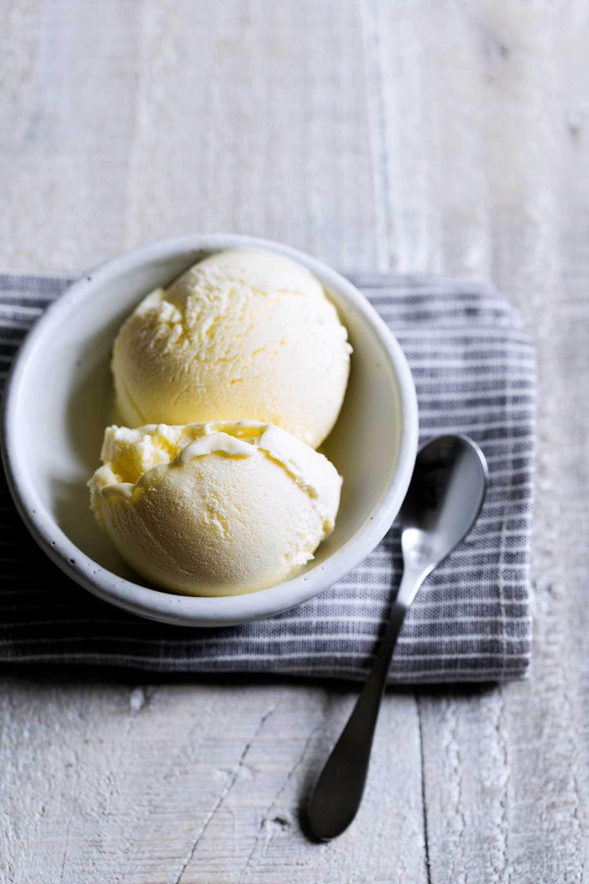 Finished lemon ice cream recipe in a bowl on a napkin