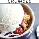 "cherry crisp recipe in a bowl topped with ice cream, plus text overlay that reads ""sweet cherry crumble"""