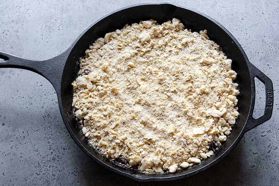 Cherry crisp topping spread evenly over the filling