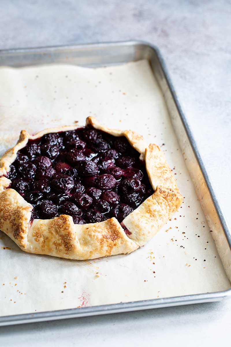 Cherry galette recipe on sheet pan just out of the oven