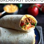 Breakfast burrito recipe the end sliced off to show the filling, with text overlay