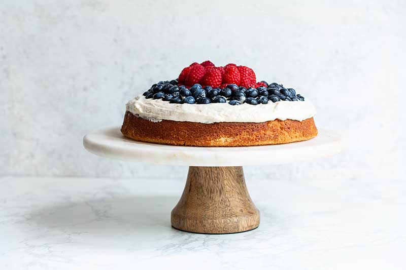 An additional layer of raspberries and blueberries added over the first to create height.