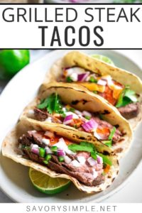 Three grilled steak tacos on an oval plate, surrounded by recipe ingredients, with text overlay.