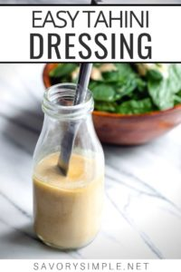 """Dressing recipe in a jar with salad in the background, and text overlay reading """"Easy Tahini Dressing"""""""